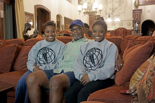 Simone Biles and her sister Adria with their dad Ronald Biles