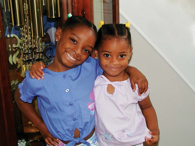 Simone Biles with her sister Adria in childhood