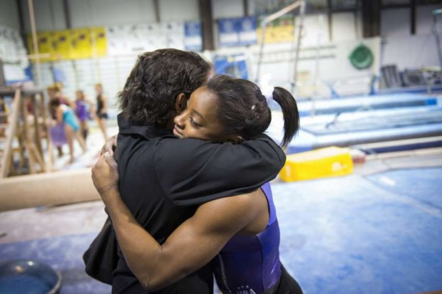 Simone Biles hugs her mom at Bannon's Gymnastix