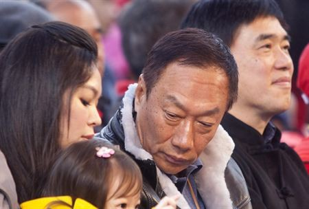 Terry Gou with his family at a charity event