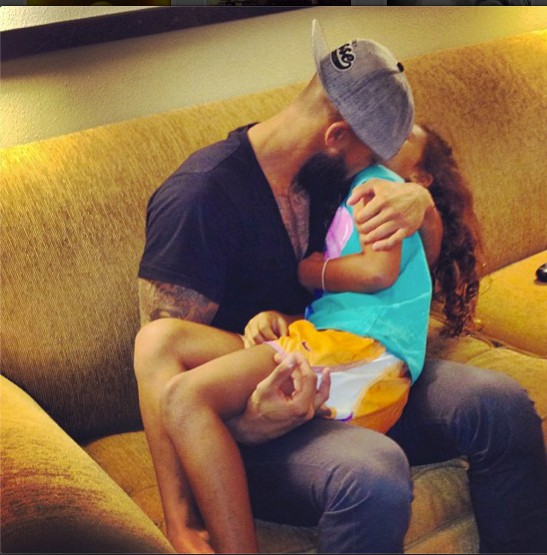 Tim playing with his daughter Alivia