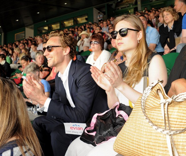 Tom watching Wimbledon game with his sister Emma