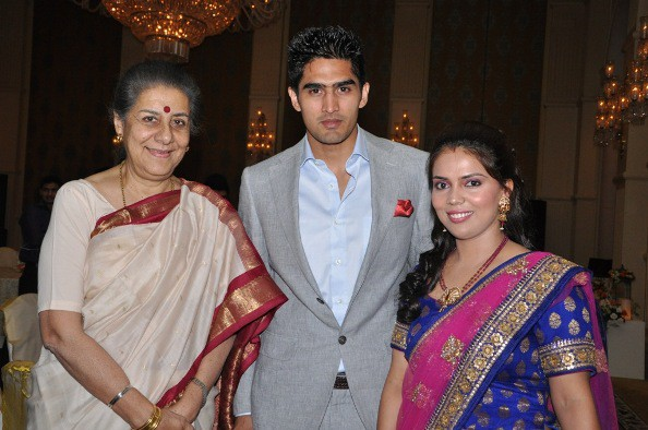 Vijender and Archana with a guest on their 1st Anniversary