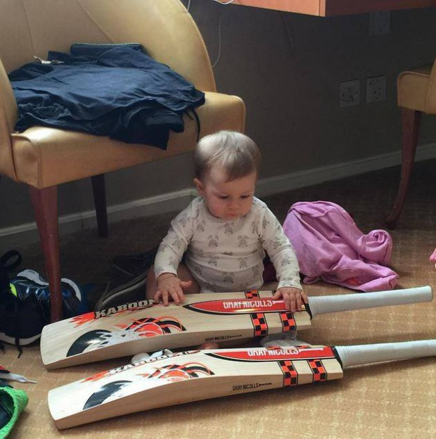 Ivy Mae checking her dad's bat