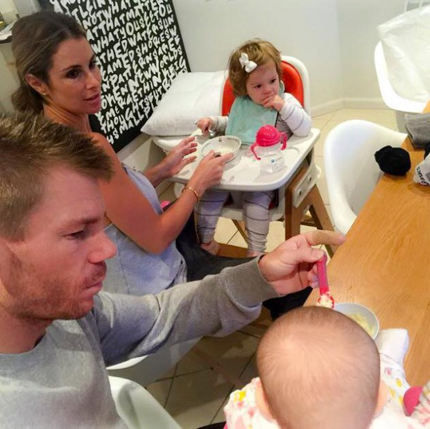 David and Candice feeding food to their children