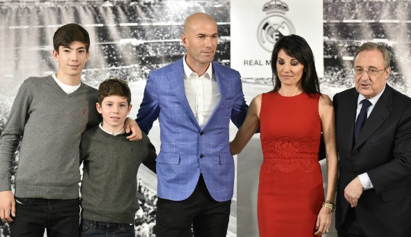 Real Madrid's new manager Zinedine Zidane poses with his wife Veronique, two of their sons, and Real Madrid's president Florentino Perez