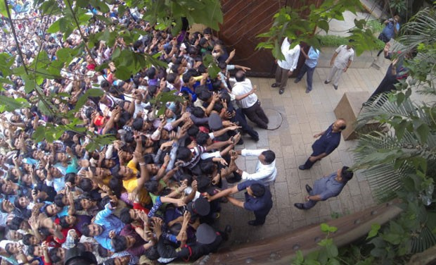 Amitabh Weaving his hands to fans at his house