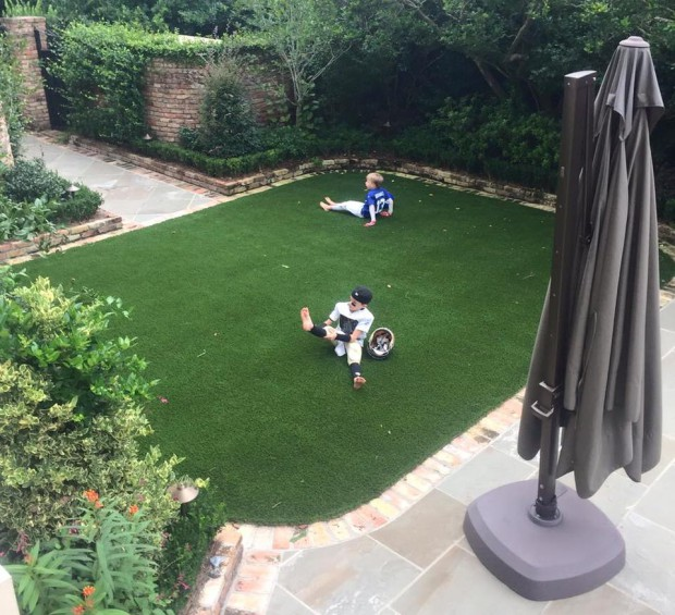 Drew Brees kids playing the house garden