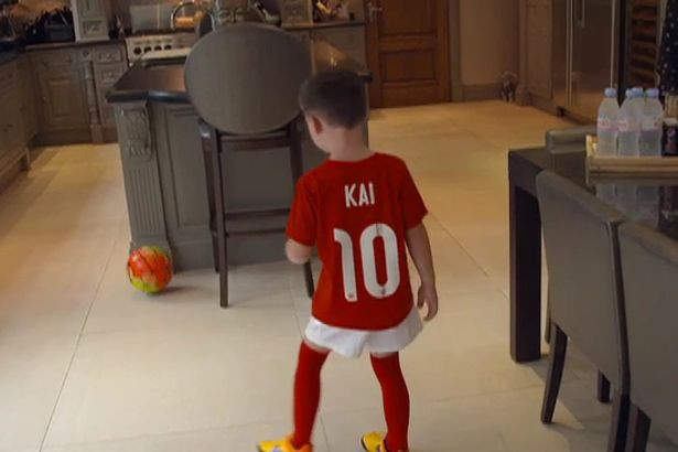 Rooney's son playing football in the kitchen