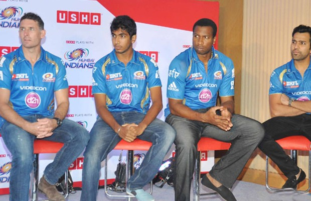 Bumrah with Hussey, Pollard and Rohit during an event