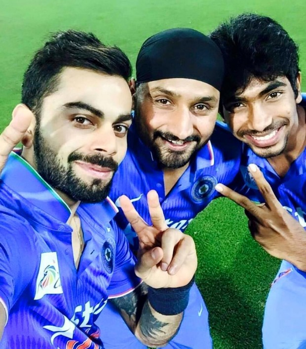 Bumrah with Kohli and Harbajan Singh