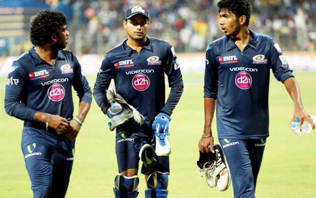 Jasprit Bumrah walking along with Aditya Tare and Lasith Malinga