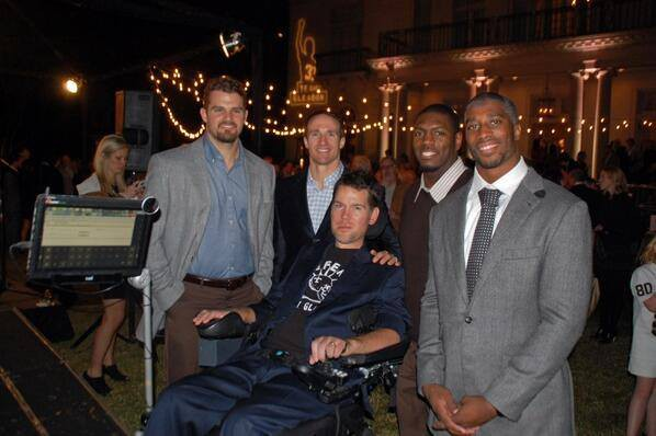 Drew Brees with fellow team mates at a fundraiser event