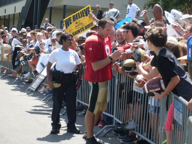 Drew Brees signing autographs to fans at New Orleans Saints training camp