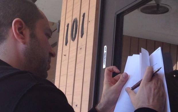Jan Signing Facebook Deal on the Door of His Old Welfare