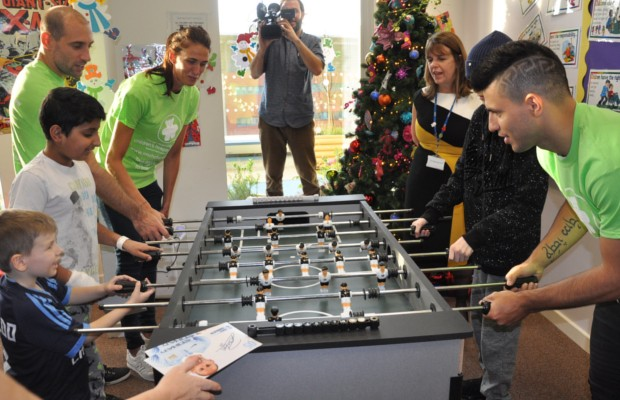 Sergio Aguero playing table football with some fans