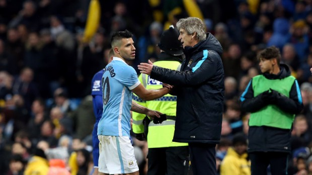Aguero with Manchester City manager Manuel Pellegrini