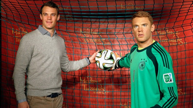 Manuel Neuer with his wax statue