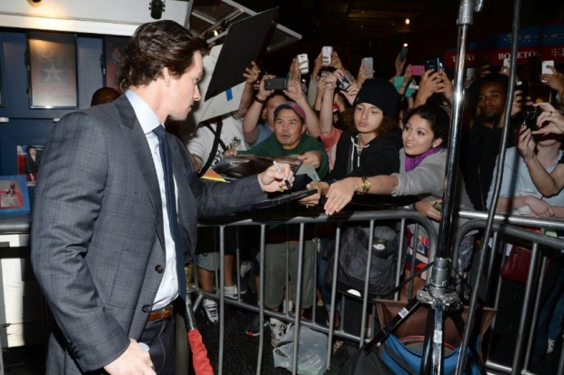 Mark Signing His Autograph to His Fans at Event of The Gambler