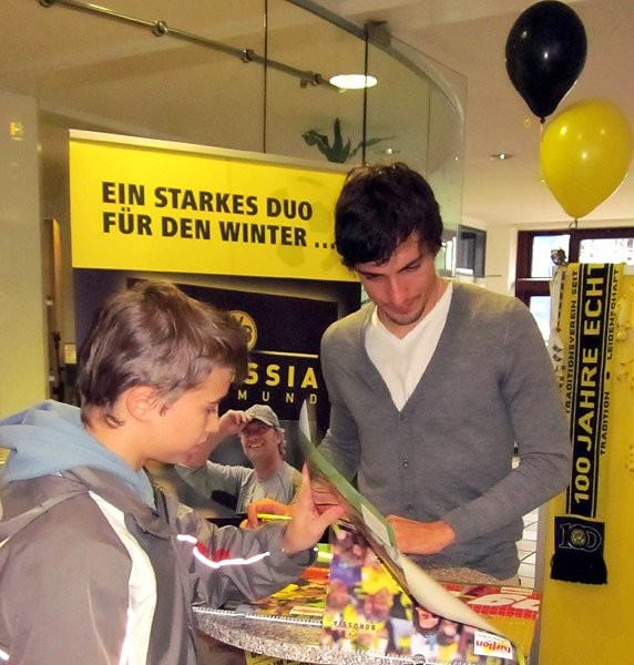 Mats Hummels Signing on Poster Calender for Dortmund Children in Need