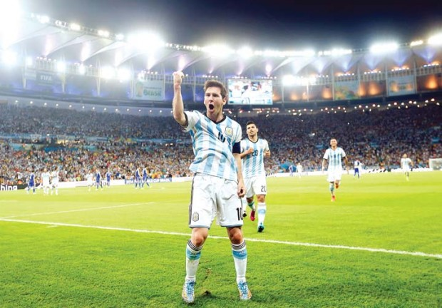Lionel Messi celebrates after scoring Argentina's second goal against Bosnia