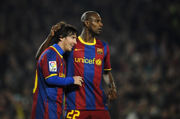 Messi with Eric Abidal
