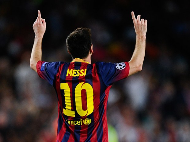 Lionel Messi celebrates after scoring the his team's second goal against Ajax