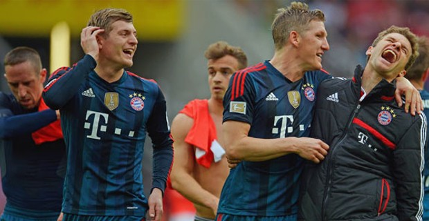 Muller with Bastian Schweinsteiger