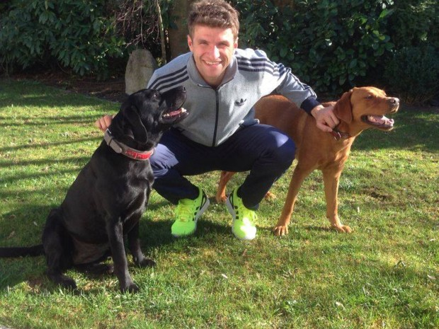 Thomas Muller with his pet dogs Marble and Mikey