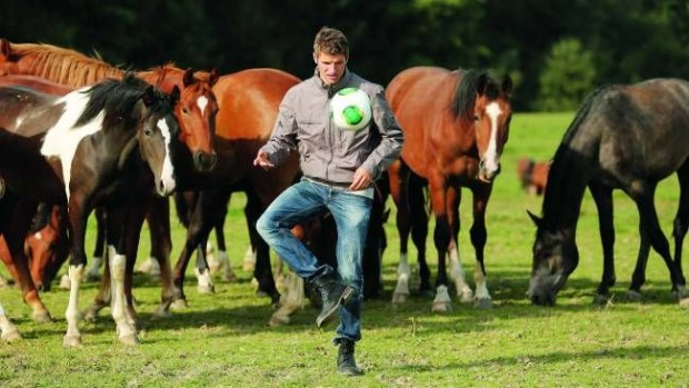 Thomas Muller playing soccer with horses
