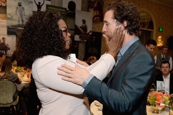 Oprah cupping  McConaugheys face