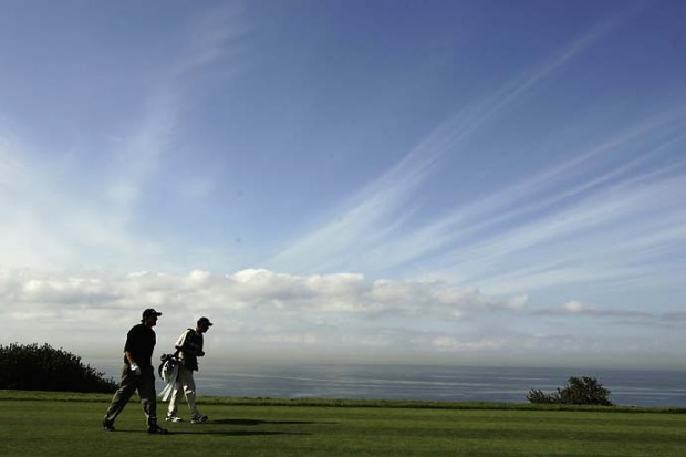 Phil Mickelson walks with caddie Jim McKay