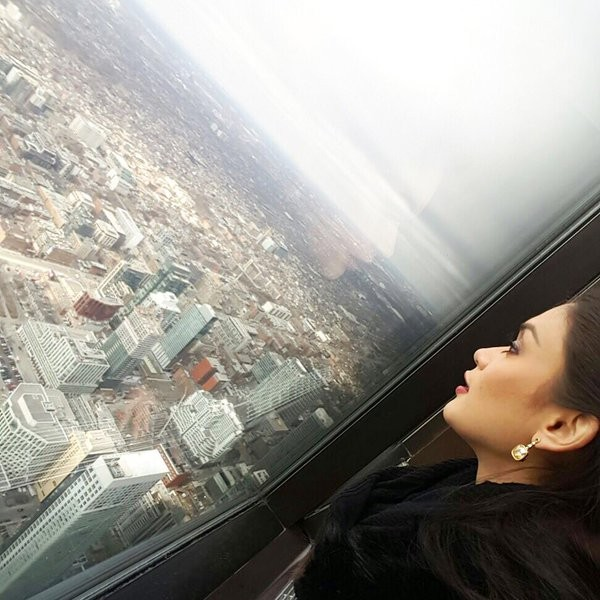 Pia Viewing Toronto City From Her Room Window