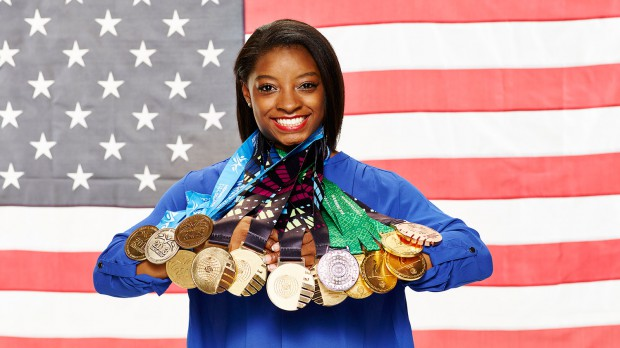 Simone Biles with all her medals and many more to come