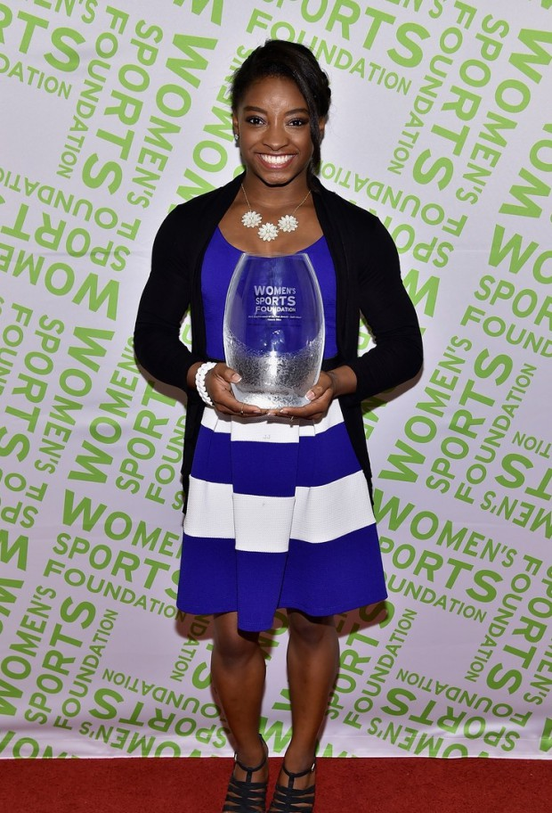 Simone Biles with her Salute To Women In Sports Awards 2014