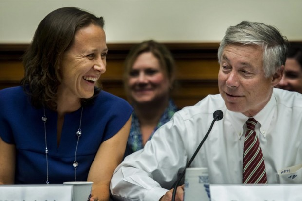 Anne Wojcicki,  jokes with Rep. Fred Upton