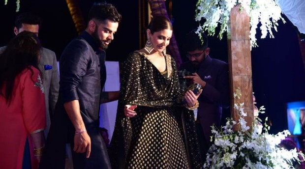 Virat with his girlfriend Anushka at Yuvi's wedding