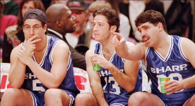 Adam Sandler, Jon Stewart and Baba Booey on the bench during a charity basketball game