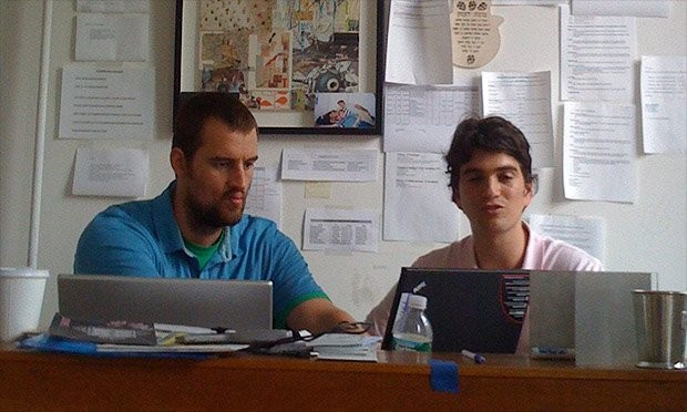 Miguel and Adam while working