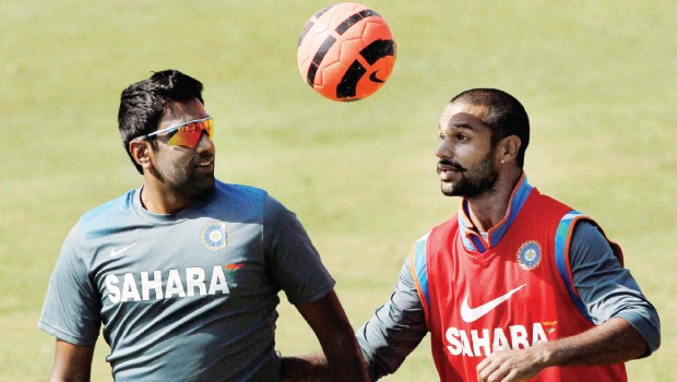 Ashwin and Shikar playing football in practice