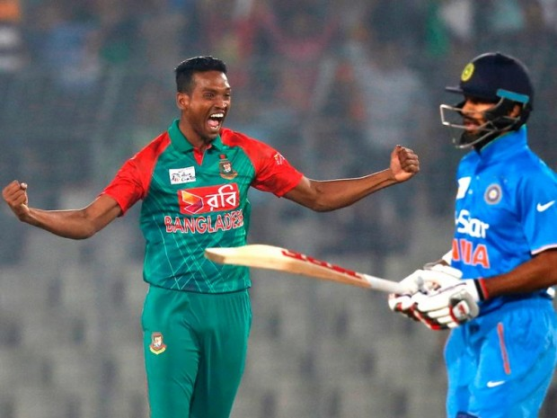 Al Amin Hossain celebrates the wicket of Shikhar Dhawan during the Asia Cup Twenty20