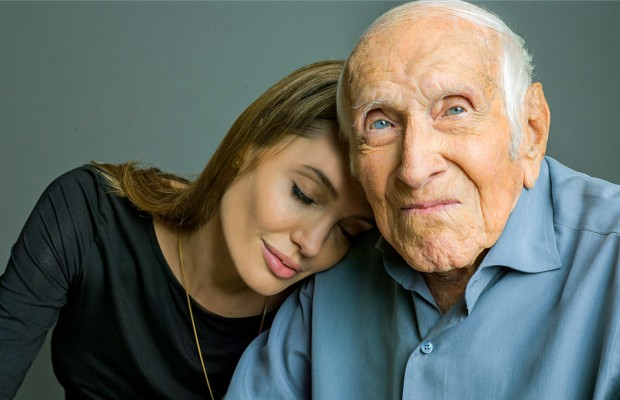 Angelina Jolie is photographed with Louis Zamperini, a U.S. Olympic distance runner and World