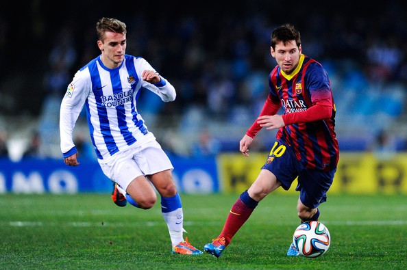 Lionel Messi and Antoine Griezmann during a match