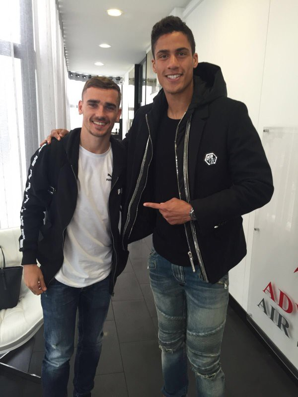 Antoine with Raphael Varane
