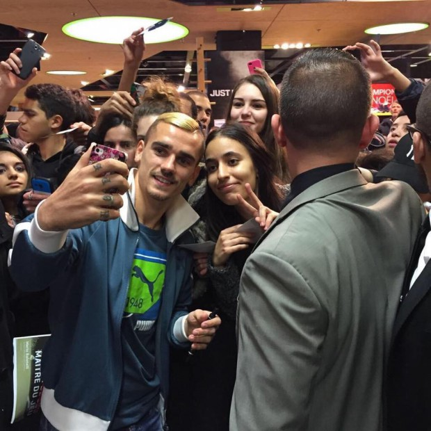 Antoine posing for a selfie with fans