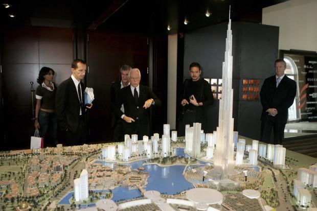 Giorgio Armani examines a model of the Burj Dubai in Dubai, December 2005