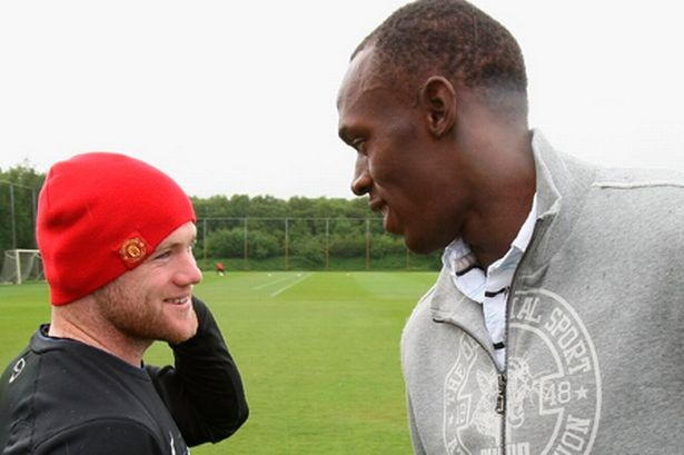 Wayne Rooney with Usain Bolt