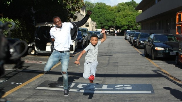 Usain Bolt races with a boy
