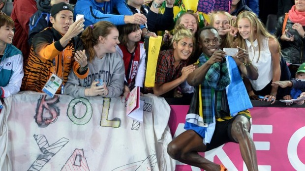 Bolt takes a selfie with his fans