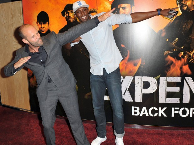 Jason Statham posing with Usain Bolt